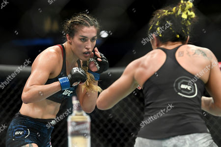 Tatiana Suarez, left, spars with Carla Esparza during their strawweight mixed martial arts bout at UFC 228, in Dallas
