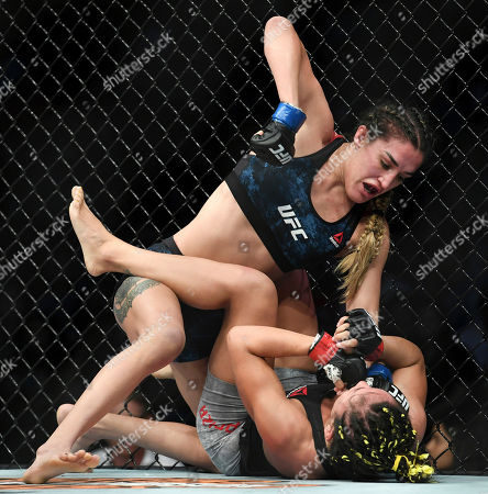 Tatiana Suarez, top, winds up to punch Carla Esparza during their strawweight mixed martial arts bout at UFC 228, in Dallas