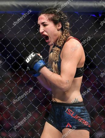 Stock Image of Tatiana Suarez celebrates after defeating Carla Esparza in their strawweight mixed martial arts bout at UFC 228, in Dallas