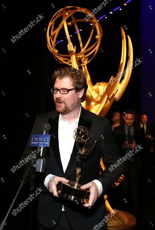 """Justin Roiland poses backstage with the award for outstanding animated program for """"Rick and Morty"""" episode """"Pickle Rick"""" at night one of the Television Academy's 2018 Creative Arts Emmy Awards at the Microsoft Theater, in Los Angeles"""