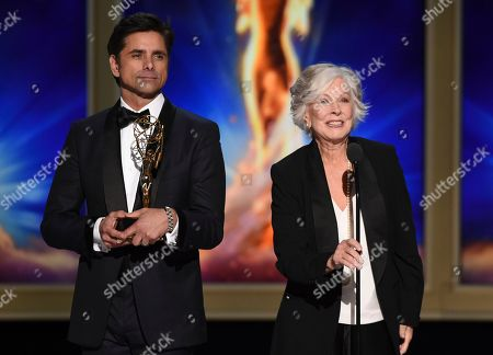 John Stamos, Christina Pickles. John Stamos, left, and Christina Pickles during night one of the Television Academy's 2018 Creative Arts Emmy Awards at the Microsoft Theater, in Los Angeles