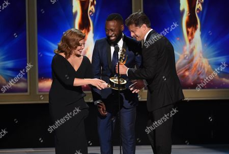 Justina Machado, left, Lamorne Morris, and Cyrille Aufort during night one of the Television Academy's 2018 Creative Arts Emmy Awards at the Microsoft Theater, in Los Angeles