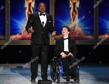 Stock Image of Cedric Yarbrough, Micah Fowler. Cedric Yarbrough, left, and Micah Fowler speak on stage during night one of the Television Academy's 2018 Creative Arts Emmy Awards at the Microsoft Theater, in Los Angeles
