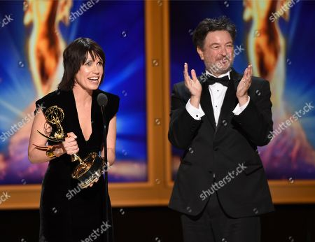 "Deborah Riley, Paul Ghirardani. Deborah Riley, left, and Paul Ghirardani accept the award for outstanding production design for a narrative period or fantasy program (one hour or more) ""Game of Thrones, Dragonstone"" during night one of the Television Academy's 2018 Creative Arts Emmy Awards at the Microsoft Theater, in Los Angeles"
