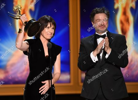 """Deborah Riley, Paul Ghirardani. Deborah Riley, left, and Paul Ghirardani accept the award for outstanding production design for a narrative period or fantasy program (one hour or more) """"Game of Thrones, Dragonstone"""" during night one of the Television Academy's 2018 Creative Arts Emmy Awards at the Microsoft Theater, in Los Angeles"""