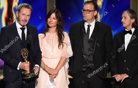"""Richard Dyer, Onnalee Blank, Mathew Waters, and Ronan Hill. Richard Dyer and, from left, Onnalee Blank, Mathew Waters, and Ronan Hill accept the award for outstanding sound mixing for a comedy or drama series (one-hour) for """"Game of Thrones"""" """"Beyond the Wall"""" during night one of the Television Academy's 2018 Creative Arts Emmy Awards at the Microsoft Theater, in Los Angeles"""
