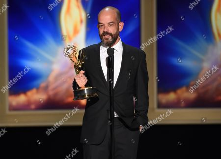 """Stock Image of Adriano Goldman accepts the award for outstanding cinematography for a single-camera series (one-hour) for the """"Beryl"""" episode of """"The Crown"""" during night one of the Television Academy's 2018 Creative Arts Emmy Awards at the Microsoft Theater, in Los Angeles"""