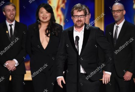"""Justin Roiland, center, and the team from the """"Pickle Rick"""" episode of """"Rick and Morty"""" during night one of the Television Academy's 2018 Creative Arts Emmy Awards at the Microsoft Theater, in Los Angeles"""