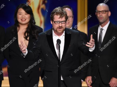 """Justin Roiland, center, and the team from """"Rick and Morty"""" during night one of the Television Academy's 2018 Creative Arts Emmy Awards at the Microsoft Theater, in Los Angeles"""