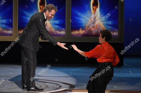 Bryan Cranston, Nina Gold. Bryan Cranston, left, and Nina Gold during night one of the Television Academy's 2018 Creative Arts Emmy Awards at the Microsoft Theater, in Los Angeles