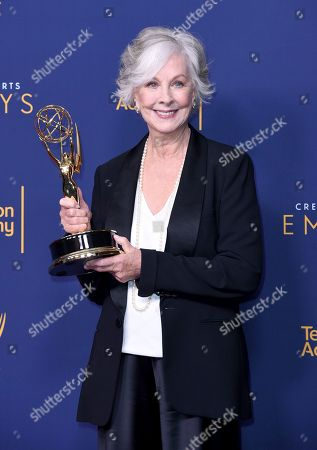 "Christina Pickles, winner of the award for outstanding actress in a short form comedy or drama series for ""Break a Hip"" poses in the press room during night one of the Creative Arts Emmy Awards at The Microsoft Theater, in Los Angeles"
