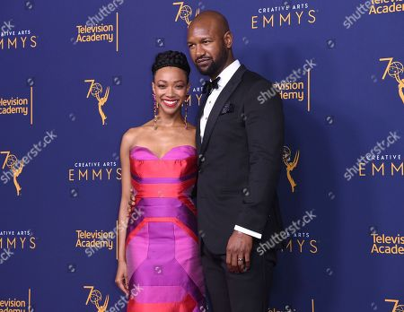 "Sonequa Martin-Green, Kenric Green. Sonequa Martin-Green, left, poses in the press room with Kenric Green after accepting the Governors Award for ""Star Trek"" during night one of the Creative Arts Emmy Awards at The Microsoft Theater, in Los Angeles"