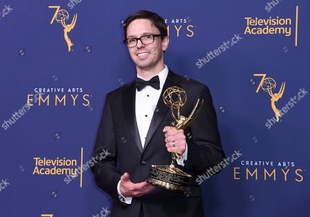"""Justin Martin, winner of the award for outstanding achievement in animation for """"The Scariest Story Ever: A Mickey Mouse Halloween Spooktacular"""", poses in the press room during night one of the Creative Arts Emmy Awards at The Microsoft Theater, in Los Angeles"""