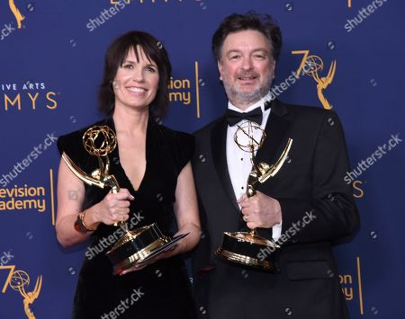 """Stock Image of Deborah Riley, Paul Ghirardani. Deborah Riley, left, and Paul Ghirardani winners of the award for outstanding production design for a narrative period or fantasy program (one hour or more) """"Game of Thrones, Dragonstone"""" pose in the press room during night one of the Creative Arts Emmy Awards at The Microsoft Theater, in Los Angeles"""