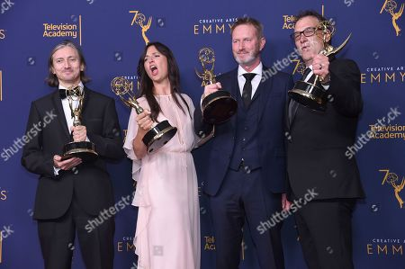 """Ronan Hill, Onnalee Blank, Richard Dyer, Mathew Waters. Ronan Hill, from left, Onnalee Blank, Richard Dyer, and Mathew Waters winners of the award for outstanding sound mixing for a comedy or drama series (one-hour) for """"Game of Thrones - Beyond The Wall"""" pose in the press room during night one of the Creative Arts Emmy Awards at The Microsoft Theater, in Los Angeles"""