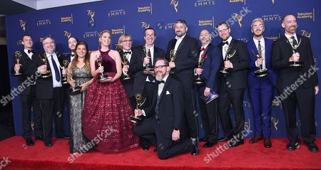 """Matthew Senreich, John Harvatine IV, Tom Root, Doug Goldstein, Keith Crofford, Ollie Green, Nick Cron-DeVico, Deirde Devlin, Mike Fasolo, Tesha Kondrat, Tom Sheppard, Alex Kamer, Scott DaRos, Matt Sheldon. The team from the """"Freshly Baked: The Robot Chicken Santa Claus Pot Cookie Freakout Special: Special Edition"""" episode of """"Robot Chicken"""" winners of the award for outstanding short form animated program pose in the press room during night one of the Creative Arts Emmy Awards at The Microsoft Theater, in Los Angeles"""