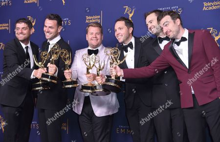 """Ben Winston, Rob Crabbe, James Corden, Adam Abramson, Ryan McKee, David Lamattina. Adam Abramson, from left, Ben Winston, James Corden, Rob Crabbe, Ryan McKee, and David Lamattina winners of the award for outstanding short form comedy or drama series for """"James Corden's Next James Corden"""" pose in the press room during night one of the Creative Arts Emmy Awards at The Microsoft Theater, in Los Angeles"""