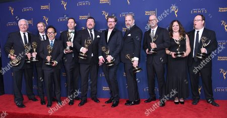 """Dan Harmon, Justin Roiland, Keith Crofford, Lee Harting, Mike McMahan, Tom Kauffman, Ollie Green, J. Michael Mendal, Jessica Gao, Wes Archer, Anthony Chun, Nathan Litz. The team from the """"Pickle Rick"""" episode of """"Rick and Morty"""" winners of the award for outstanding animated program pose in the press room during night one of the Creative Arts Emmy Awards at The Microsoft Theater, in Los Angeles"""