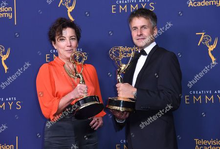 """Nina Gold, Robert Sterne. Nina Gold, left, and Robert Sterne winners of the award for outstanding casting for a drama series for """"The Crown"""" pose in the press room during night one of the Creative Arts Emmy Awards at The Microsoft Theater, in Los Angeles"""