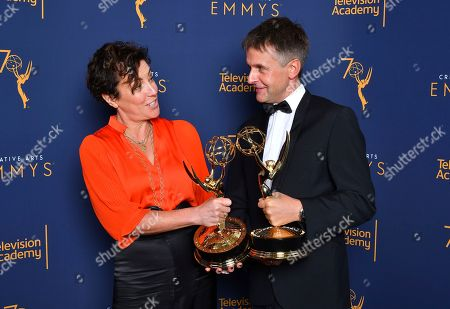 """Robert Sterne, Nina Gold. Nina Gold, left, and Robert Sterne, hold their awards for Outstanding Casting for a Drama Series for """"The Crown"""", while posing for a portrait during night one of the Television Academy's 2018 Creative Arts Emmy Awards at the Microsoft Theater, in Los Angeles"""