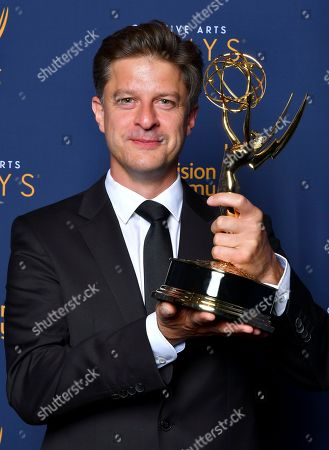"""Stock Photo of Cyrille Aufort, winner of the award for outstanding music composition for a limited series, movie or special (original dramatic score) for """"March of the Penguins 2: The Next Step"""" poses for a portrait during night one of the Television Academy's 2018 Creative Arts Emmy Awards at the Microsoft Theater, in Los Angeles"""