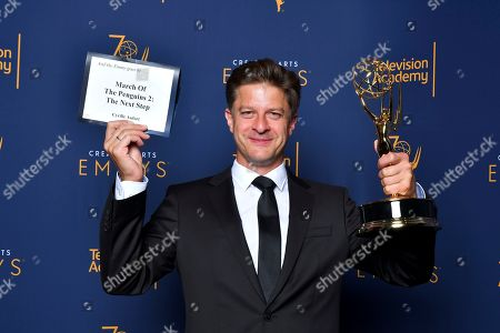 """Stock Picture of Cyrille Aufort, winner of the award for outstanding music composition for a limited series, movie or special (original dramatic score) for """"March of the Penguins 2: The Next Step"""" poses for a portrait during night one of the Television Academy's 2018 Creative Arts Emmy Awards at the Microsoft Theater, in Los Angeles"""