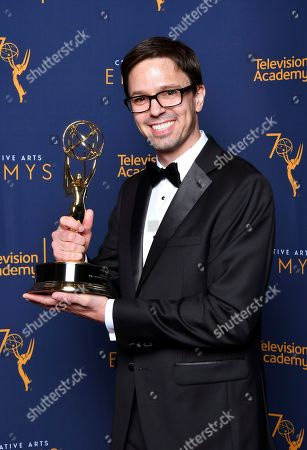 """Justin Martin, winner of the award for outstanding achievement in animation for """"The Scariest Story Ever: A Mickey Mouse Halloween Spooktacular"""" poses for a portrait during night one of the Television Academy's 2018 Creative Arts Emmy Awards at the Microsoft Theater, in Los Angeles"""