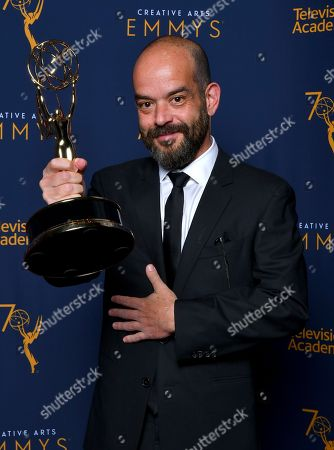 """Adriano Goldman, winner of the award for outstanding cinematography for a single-camera series (one-hour) for the """"Beryl"""" episode of """"The Crown"""" poses for a portrait during night one of the Television Academy's 2018 Creative Arts Emmy Awards at the Microsoft Theater, in Los Angeles"""
