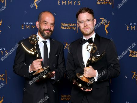 Stock Photo of Christian Sprenger, Adriano Goldman. Adriano Goldman, left, and Christian Sprenger, pose for a portrait during night one of the Television Academy's 2018 Creative Arts Emmy Awards at the Microsoft Theater, in Los Angeles