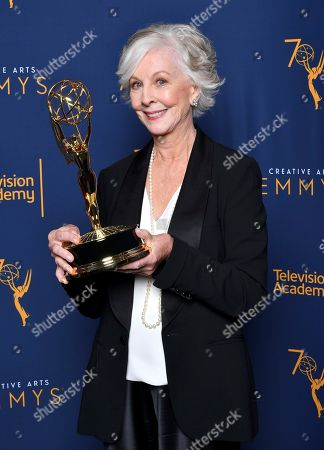 "Christina Pickles, winner of the award for outstanding actress in a short form comedy or drama series for ""Break A Hip"" poses for a portrait during night one of the Television Academy's 2018 Creative Arts Emmy Awards at the Microsoft Theater, in Los Angeles"