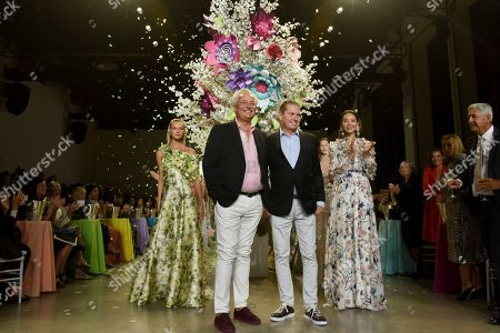 Mark Badgley, James Mischka. Designers Mark Badgley, center left, and James Mischka, center right, greet the audience after Badgley Mischka's 30th anniversary and spring 2019 runway show during New York Fashion Week