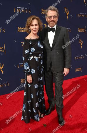 Robin Dearden, Bryan Cranston. Robin Dearden, left, and Bryan Cranston arrive at night one of the Television Academy's 2018 Creative Arts Emmy Awards at the Microsoft Theater, in Los Angeles