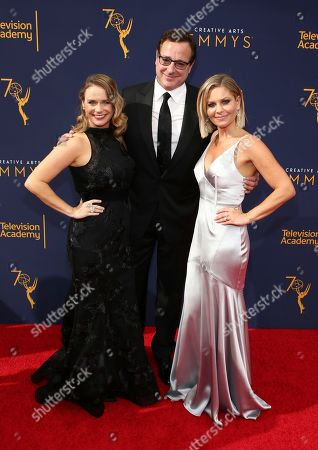 Andrea Barber, Bob Saget, Candace Cameron Bure. Andrea Barber, from left, Bob Saget and Candace Cameron Bure arrive at night one of the Television Academy's 2018 Creative Arts Emmy Awards at the Microsoft Theater, in Los Angeles