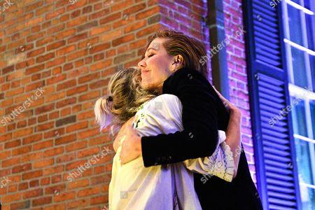 Martha Wainwright is embraced by Maggie Gyllenhaal