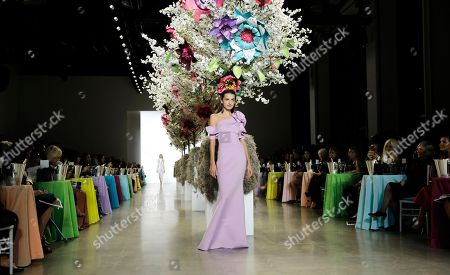 A model exhibits a creation by Badgley Mischka at New York Fashion Week Spring 2019 in New York, New York, USA, 08 September 2018. James Mischka and Mark Badgley are celebrating the 30th anniversary of their fashion label.