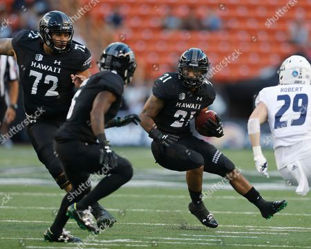 Hawaii running back Fred Holly III (21) carries against Rice during the first quarter of an NCAA college football game, in Honolulu