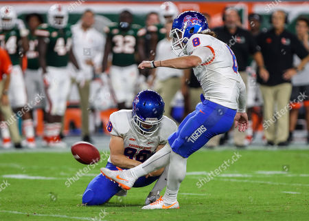 Stock Photo of Savannah State Tigers place kicker Giovanni Lugo (8) kicks the ball, held by punter Chandler Williams (98), during the college football game between the Savannah State Tigers and the Miami Hurricanes at the Hard Rock Stadium in Miami Gardens, Florida. The Hurricanes won 77-0