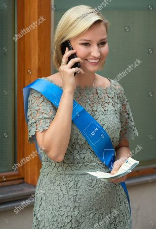 Ebba Busch Thor, the leader of the Swedish Christian Democrats, uses her smartphone as she campaigns for her party outside a polling station in central Stockholm, Sweden, 09 September 2018. About 7.5 million Swedes are eligible to vote in the country?s general elections on 09 September that are expected to see huge gains for the far-right Sweden Democrats (SD) party and losses for the ruling coalition of Social Democrtas and the Green party. The previous election campaign has been dominated by a controversial debate over the country?s immigration policy.