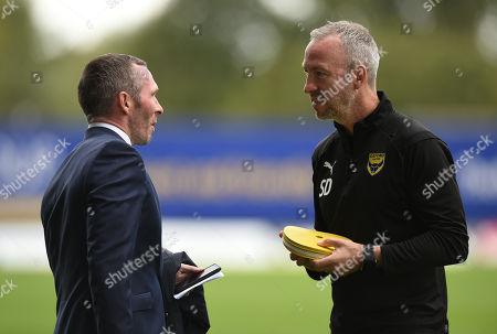 Former Oxford United manager Michael Appleton talks with Oxford United assistant Shaun Derry