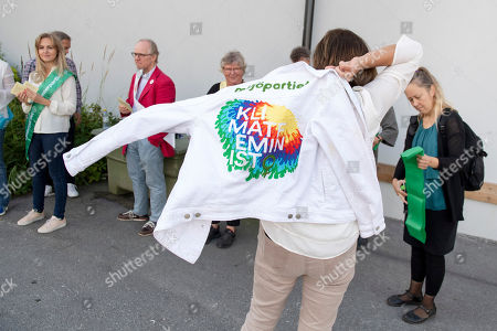 Swedish Minister for International Development Cooperation and Climate, and Deputy Prime Minister Isabella Lovin (C, back to camera) puts on a 'Milijopartiet' party jacket as she arrives to cast her vote during election day in Sweden at the Viks School in Varmdo, close to Stockholm, Sweden, 09 September 2018. About 7.5 million Swedes are eligible to vote in the country?s general elections on 09 September that are expected to see huge gains for the far-right Sweden Democrats (SD) party and losses for the ruling coalition of Social Democrtas and the Green party. The previous election campaign has been dominated by a controversial debate over the country?s immigration policy.