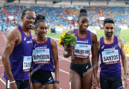Christian Taylor of the U.S., Stephanie Ann McPherson of Jamaica, Shaunae Miller-Uibo of the Bahamas, and Luguelin Santos of the Dominican Republic, from left, pose for a team picture after winning the mixed 4x400 meters relay for the Americas at the IAAF track and field Continental Cup in Ostrava, Czech Republic