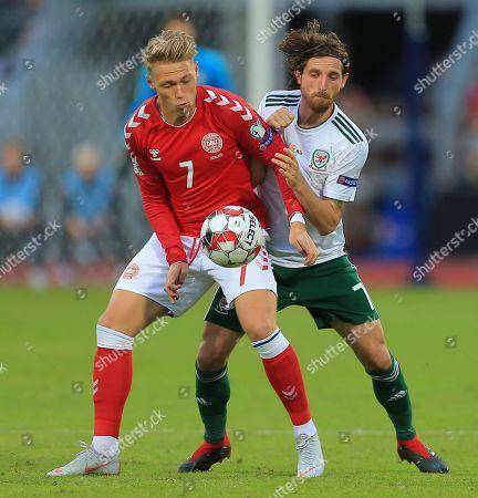 Joe Allen of Wales battles with Viktor Fischer of Denmark