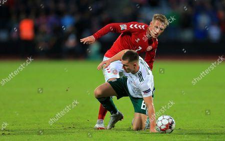 Ben Woodburn battles with Viktor Fischer of Denmark