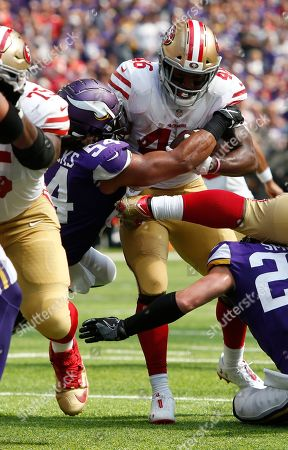 San Francisco 49ers running back Alfred Morris (46) is tackled by Minnesota Vikings linebacker Eric Kendricks (54) during the first half of an NFL football game, in Minneapolis