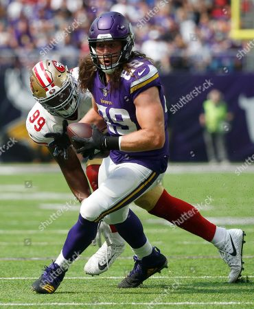 Minnesota Vikings tight end David Morgan (89) runs from San Francisco 49ers defensive end DeForest Buckner (99) after making a reception during the second half of an NFL football game, in Minneapolis