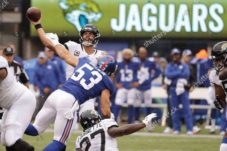 Jacksonville Jaguars quarterback Blake Bortles (5) throws a pass over New York Giants' Connor Barwin (53) during the first half of an NFL football game, in East Rutherford, N.J