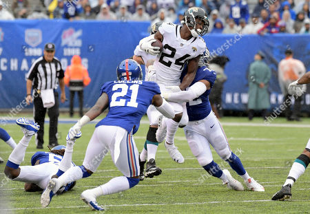 Jacksonville Jaguars running back T.J. Yeldon (24) is tackled by New York Giants defensive end Kerry Wynn (72) as defensive back Landon Collins (21) closes in during the first half of an NFL football game, in East Rutherford, N.J