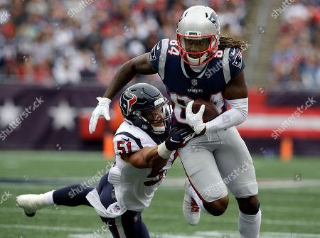 New England Patriots wide receiver Cordarrelle Patterson (84) eludes Houston Texans linebacker Dylan Cole (51) after catching a pass during the second half of an NFL football game, in Foxborough, Mass