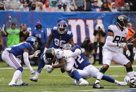 T.T. Yeldon Jacksonville Jaguars Running Back (24) is tackled by Kerry Wynn New York Giants Defensive End (72).