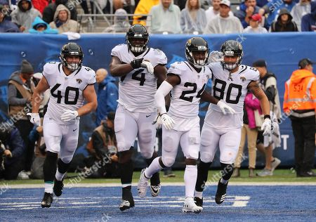 T.T. Yeldon Jacksonville Jaguars Running Back (24) celebrates scoring a touchdown with Tommy Bohanon, Cam Robinson and James O?Shaughnessy.